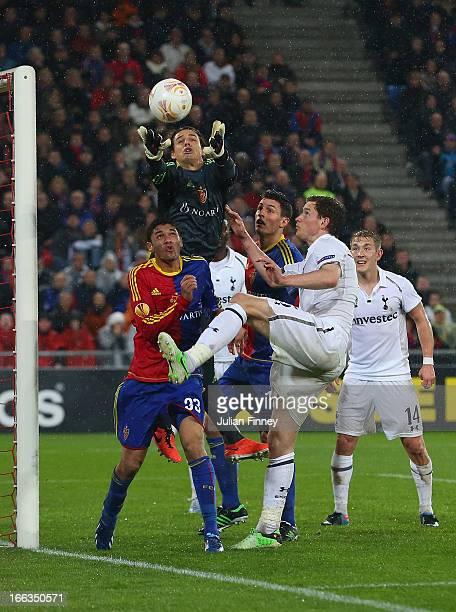 Jan Vertonghen of Spurs battles with Mohamed Elneny of FC Basel and goalkeeper Yann Sommer of FC Basel during the UEFA Europa League Quarter Final...