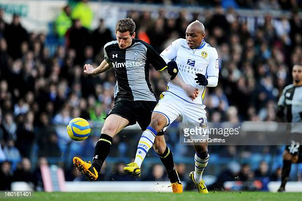 Jan Vertonghen of Spurs is challenged by ElHadji Diouf of Leeds during the FA Cup with Budweiser Fourth Round match between Leeds United and...