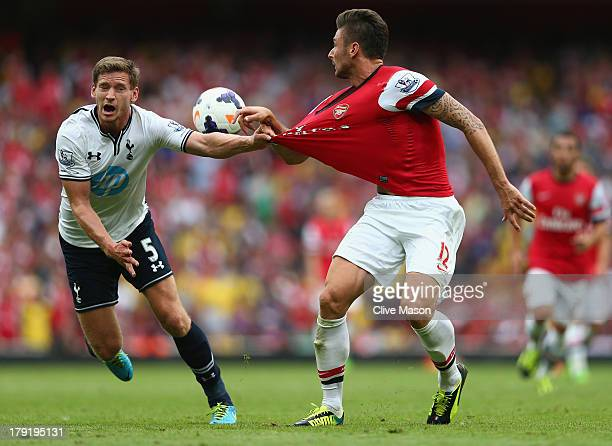 Jan Vertonghen of Spurs pulls on the shirt of Olivier Giroud of Arsenal during the Barclays Premier League match between Arsenal and Tottenham...