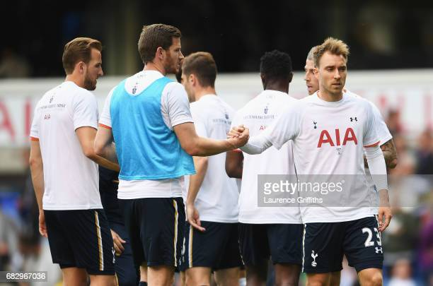 Jan Vertonghen of Tottenham Hotspur and Christian Eriksen of Tottenham Hotspur shake hands while they warm up prior to the Premier League match...
