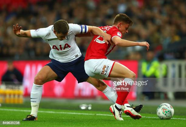 Jan Vertonghen of Tottenham Hotspur and Harvey Barnes of Barnsley battle for possession during the Carabao Cup Third Round match between Tottenham...