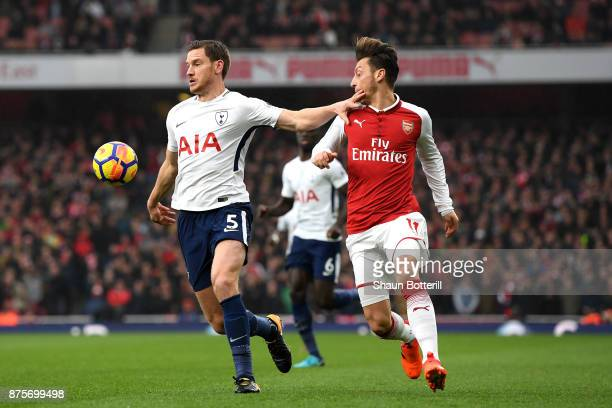 Jan Vertonghen of Tottenham Hotspur and Mesut Ozil of Arsenal battle for possession during the Premier League match between Arsenal and Tottenham...