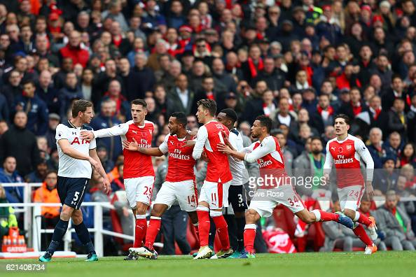 Jan Vertonghen of Tottenham Hotspur and Theo Walcott of Arsenal clash during the Premier League match between Arsenal and Tottenham Hotspur at...