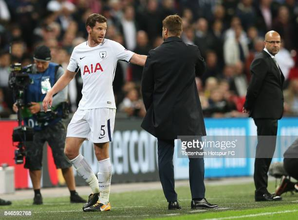 Jan Vertonghen of Tottenham Hotspur argues with Mauricio Pochettino Manager of Tottenham Hotspur after being sent off during the UEFA Champions...