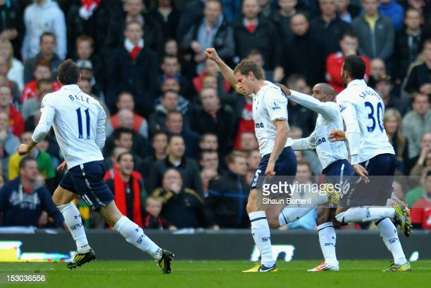Jan Vertonghen of Tottenham Hotspur celebrates scoring the opening goal with team mates Gareth Bale Jermain Defoe and Sandro during the Barclays...