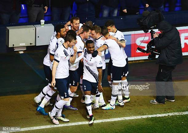 Jan Vertonghen of Tottenham Hotspur celebrates with team mates as Craig Dawson of West Bromwich Albion scores an own goal for their first goal during...