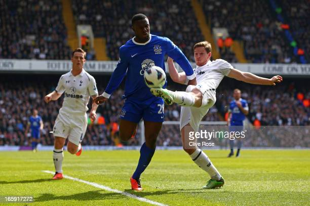 Jan Vertonghen of Tottenham Hotspur clears the ball from Victor Anichebe of Everton during the Barclays Premier League match between Tottenham...