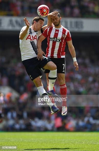 Jan Vertonghen of Tottenham Hotspur competes in an arial duel with Shane Long of Southampton during the Barclays Premier League match between...
