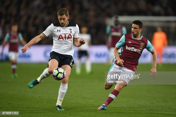 Jan Vertonghen of Tottenham Hotspur controls the ball as Jonathan Calleri of West Ham United closes in during the Premier League match between West...