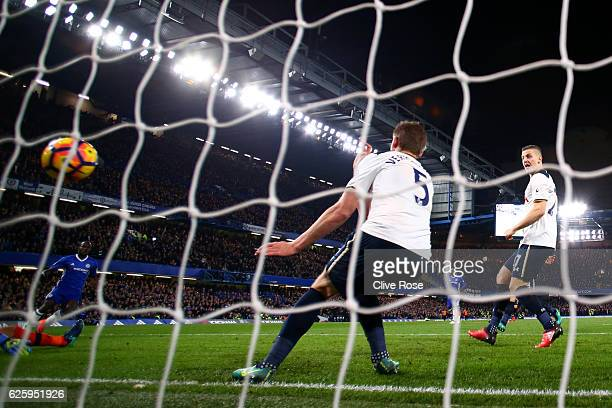 Jan Vertonghen of Tottenham Hotspur fails to clear the shot by Victor Moses of Chelsea allowing to score the second goal during the Premier League...