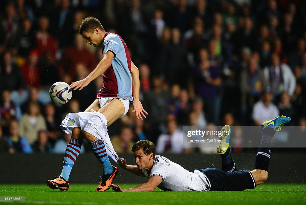 <a gi-track='captionPersonalityLinkClicked' href=/galleries/search?phrase=Jan+Vertonghen&family=editorial&specificpeople=1360499 ng-click='$event.stopPropagation()'>Jan Vertonghen</a> of Tottenham Hotspur hangs on to the shorts of <a gi-track='captionPersonalityLinkClicked' href=/galleries/search?phrase=Nicklas+Helenius&family=editorial&specificpeople=8797037 ng-click='$event.stopPropagation()'>Nicklas Helenius</a> of Aston Villa during the Capital One Cup third round match between Aston Villa and Tottenham Hotspur at Villa Park on September 24, 2013 in Birmingham, England.