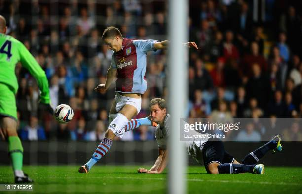 Jan Vertonghen of Tottenham Hotspur hangs on to the shorts of Nicklas Helenius of Aston Villa during the Capital One Cup third round match between...