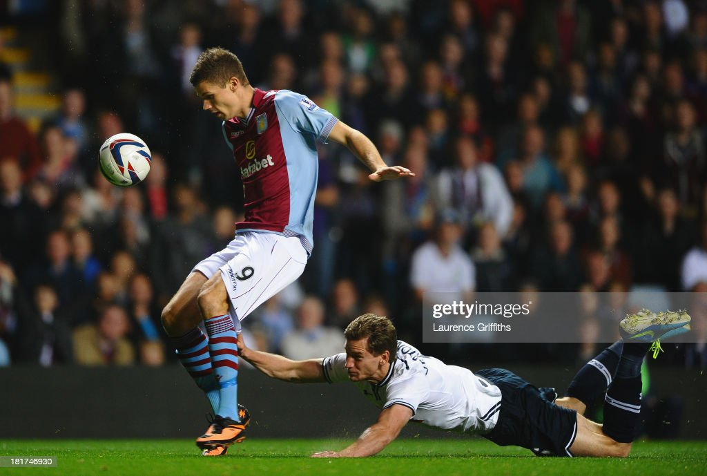 Jan Vertonghen of Tottenham Hotspur hangs on to the shorts of Nicklas Helenius of Aston Villa during the Capital One Cup third round match between Aston Villa and Tottenham Hotspur at Villa Park on September 24, 2013 in Birmingham, England.