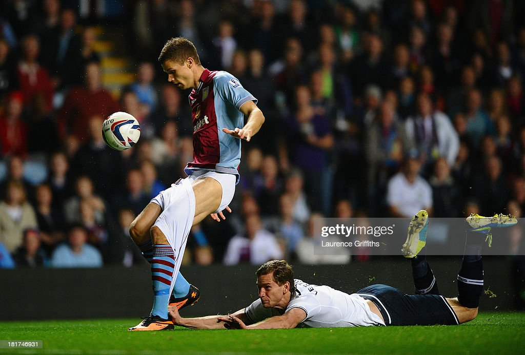 <a gi-track='captionPersonalityLinkClicked' href=/galleries/search?phrase=Jan+Vertonghen&family=editorial&specificpeople=1360499 ng-click='$event.stopPropagation()'>Jan Vertonghen</a> of Tottenham Hotspur hangs on to the shorts of Nicklas Helenius of Aston Villa during the Capital One Cup third round match between Aston Villa and Tottenham Hotspur at Villa Park on September 24, 2013 in Birmingham, England.