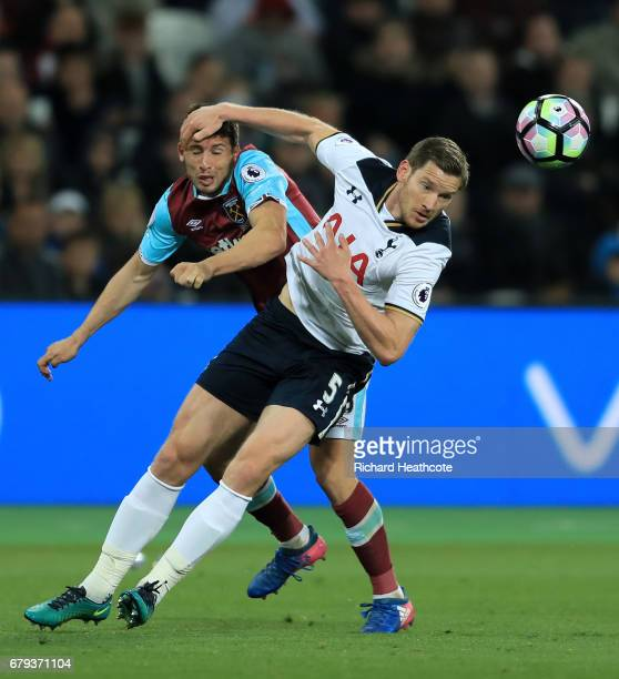 Jan Vertonghen of Tottenham Hotspur heads the ball clear under pressure from Jonathan Calleri of West Ham United during the Premier League match...