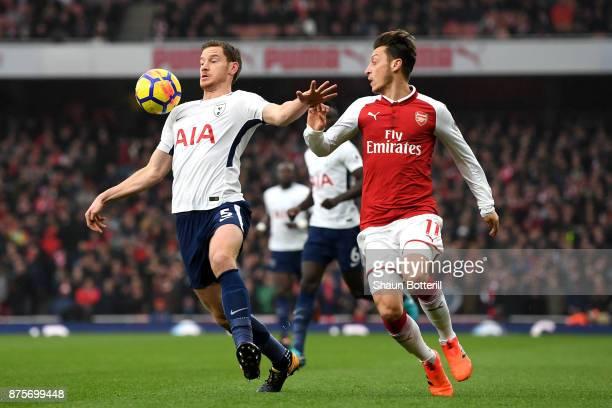 Jan Vertonghen of Tottenham Hotspur holds off Mesut Ozil of Arsenal during the Premier League match between Arsenal and Tottenham Hotspur at Emirates...