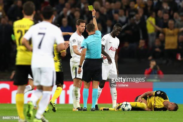 Jan Vertonghen of Tottenham Hotspur is shown a yellow card by referee Gianluca Rocchi during the UEFA Champions League group H match between...