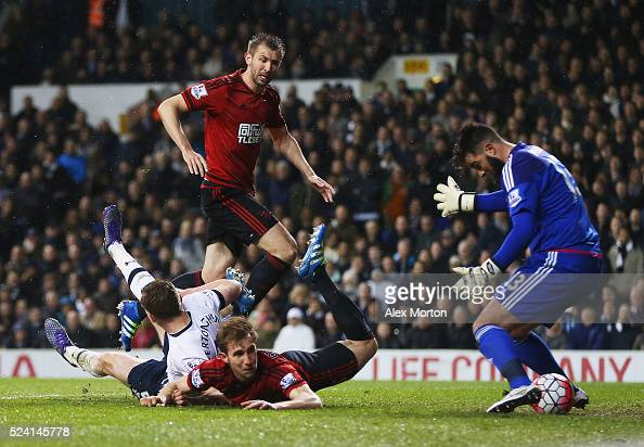 Jan Vertonghen of Tottenham Hotspur pressures Craig Dawson of West Bromwich Albion into scoring an own goal for their first past goalkeeper Boaz...