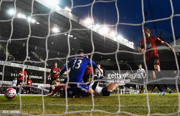 Jan Vertonghen of Tottenham Hotspur pressures Craig Dawson of West Bromwich Albion into scoring an own goal for their first goal past goalkeeper Boaz...