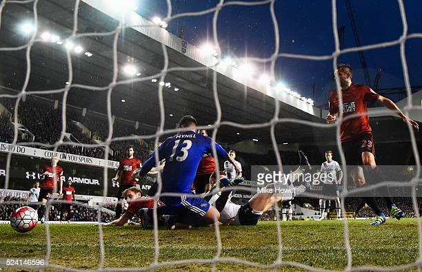 Jan Vertonghen of Tottenham Hotspur pressures Craig Dawson of West Bromwich Albion into scoring an own goal for their first goal past goalkeeper Boaz...