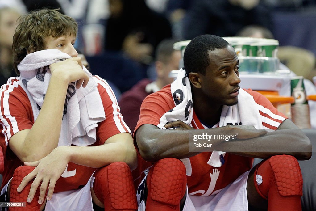 <a gi-track='captionPersonalityLinkClicked' href=/galleries/search?phrase=Jan+Vesely&family=editorial&specificpeople=5620499 ng-click='$event.stopPropagation()'>Jan Vesely</a> #24 (L) and teammate <a gi-track='captionPersonalityLinkClicked' href=/galleries/search?phrase=Earl+Barron&family=editorial&specificpeople=234747 ng-click='$event.stopPropagation()'>Earl Barron</a> #30 (R) of the Washington Wizards sit on the bench during the closing moments of the Wizards 118-92 loss to the San Antonio Spurs at Verizon Center on November 26, 2012 in Washington, DC.