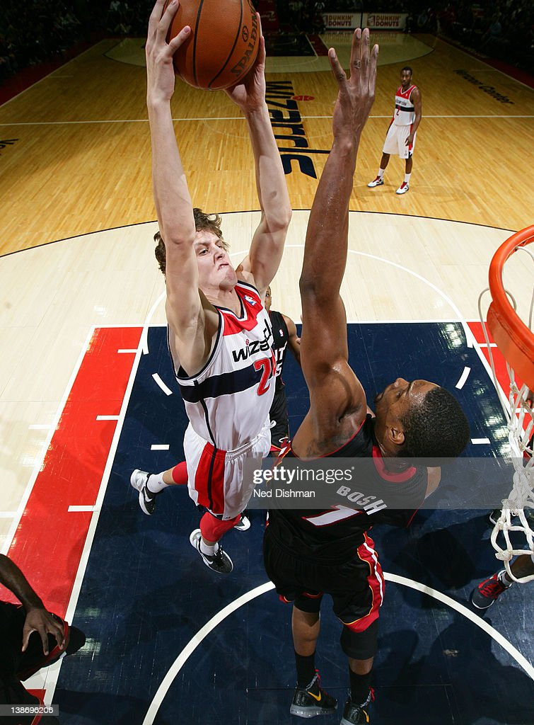 <a gi-track='captionPersonalityLinkClicked' href=/galleries/search?phrase=Jan+Vesely&family=editorial&specificpeople=5620499 ng-click='$event.stopPropagation()'>Jan Vesely</a> #24 of the Washington Wizards dunks against <a gi-track='captionPersonalityLinkClicked' href=/galleries/search?phrase=Chris+Bosh&family=editorial&specificpeople=201574 ng-click='$event.stopPropagation()'>Chris Bosh</a> #1 of the Miami Heat during the game at the Verizon Center on February 10, 2012 in Washington, DC.