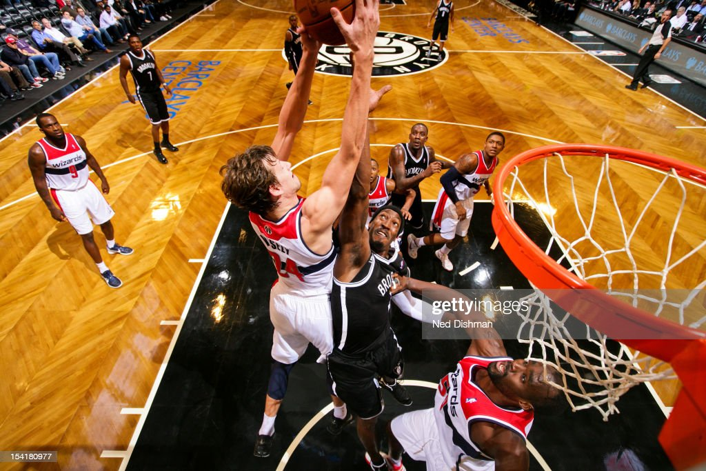 <a gi-track='captionPersonalityLinkClicked' href=/galleries/search?phrase=Jan+Vesely&family=editorial&specificpeople=5620499 ng-click='$event.stopPropagation()'>Jan Vesely</a> #24 of the Washington Wizards goes for a rebound against <a gi-track='captionPersonalityLinkClicked' href=/galleries/search?phrase=Gerald+Wallace&family=editorial&specificpeople=202117 ng-click='$event.stopPropagation()'>Gerald Wallace</a> #45 of the Brooklyn Nets at the Barclays Center on October 15, 2012 in the Brooklyn borough of New York City.