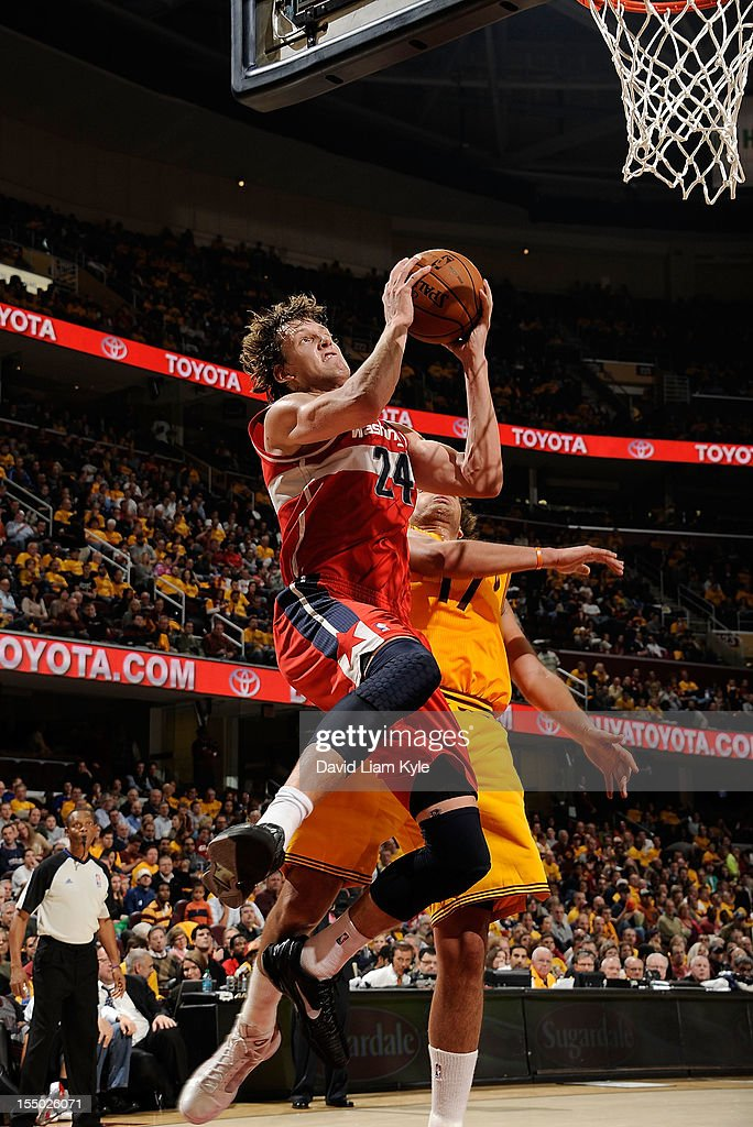 Jan Vesely #24 of the Washington Wizards goes up for the basket against <a gi-track='captionPersonalityLinkClicked' href=/galleries/search?phrase=Anderson+Varejao&family=editorial&specificpeople=202247 ng-click='$event.stopPropagation()'>Anderson Varejao</a> #17 of the Cleveland Cavaliers at The Quicken Loans Arena on October 30, 2012 in Cleveland, Ohio.