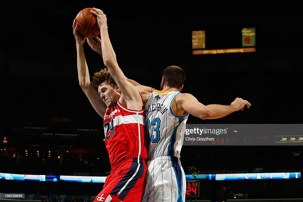 Jan Vesely #24 of the Washington Wizards grabs a rebound over Ryan Anderson #33 of the New Orleans Hornets at New Orleans Arena on December 11, 2012 in New Orleans, Louisiana.