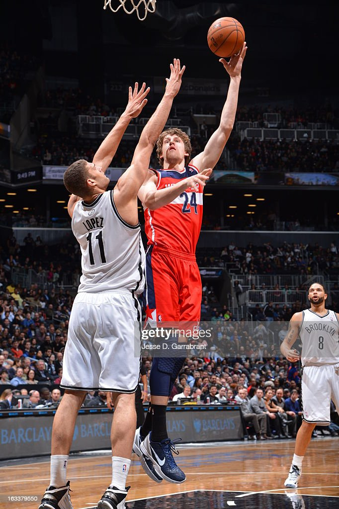 <a gi-track='captionPersonalityLinkClicked' href=/galleries/search?phrase=Jan+Vesely&family=editorial&specificpeople=5620499 ng-click='$event.stopPropagation()'>Jan Vesely</a> #24 of the Washington Wizards shoots a layup against Brook Lopez #11 of the Brooklyn Nets on March 8, 2013 at the Barclays Center in Brooklyn, New York.