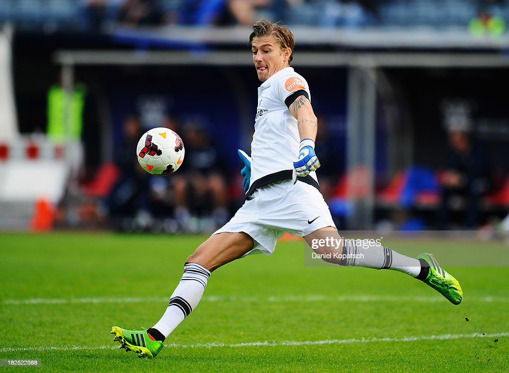 Jan Zimmermann of Darmstadt kicks the ball during the third Bundesliga match between 1. FC Saarbruecken and Darmstadt 98 on September 28, 2013 in Saarbruecken, Germany.