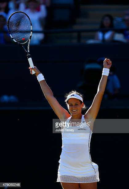 Jana Cepelova of Slovakia celebrates winning her Ladies Singles first round match against Simona Halep of Romania during day two of the Wimbledon...