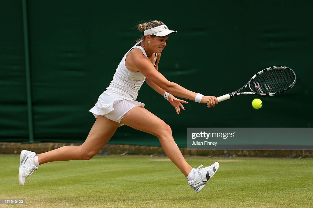 Jana Cepelova of Slovakia plays a backhand during the Ladies' Singles second round match against Roberta Vinci of Italy on day four of the Wimbledon Lawn Tennis Championships at the All England Lawn Tennis and Croquet Club on June 27, 2013 in London, England.