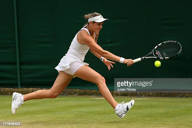 Jana Cepelova of Slovakia plays a backhand during the Ladies' Singles second round match against Roberta Vinci of Italy on day four of the Wimbledon...