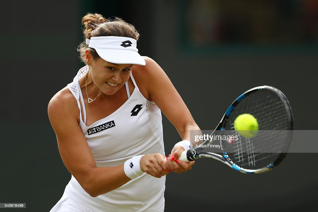 Jana Cepelova of Slovakia plays a backhand during the Ladies Singles second round match against Gabrine Muguruza of Spain on day four of the Wimbledon Lawn Tennis Championships at the All England Lawn Tennis and Croquet Club on June 30, 2016 in London, England.