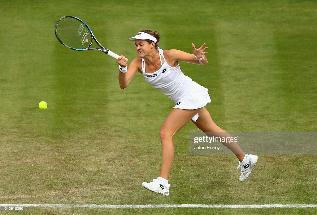 Jana Cepelova of Slovakia plays a forehand during the Ladies Singles second round match against Gabrine Muguruza of Spain on day four of the Wimbledon Lawn Tennis Championships at the All England Lawn Tennis and Croquet Club on June 30, 2016 in London, England.