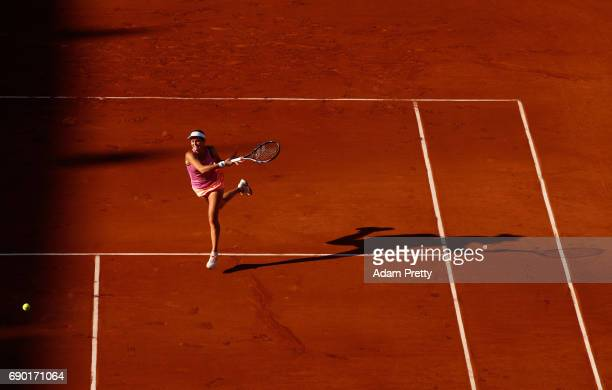 Jana Cepelova of Slovakia plays a forehand during the ladies singles first round match against Simona Halep of Romania on day three of the 2017...