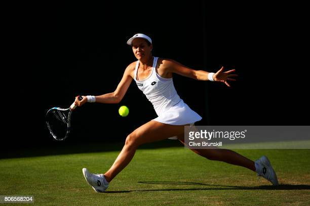 Jana Cepelova of Slovakia plays a forehand during the Ladies Singles first round match against Caroline Garcia of France on day one of the Wimbledon...