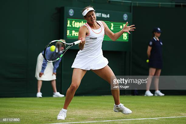 Jana Cepelova of Slovakia returns a shot against Flavia Pennetta of Italy during her Ladies' Singles first round match on day one of the Wimbledon...