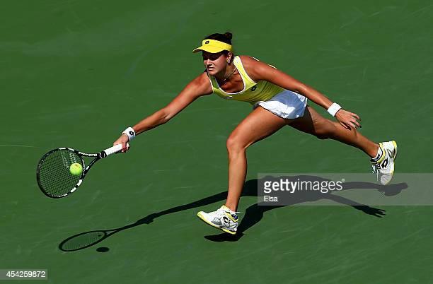 Jana Cepelova of Slovakia returns a shot to Simona Halep of Romania on Day Three of the 2014 US Open at the USTA Billie Jean King National Tennis...