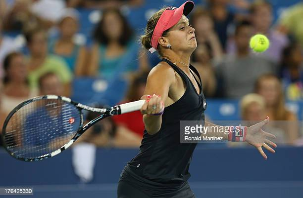 Jana Cepelova of Slovakia returns a shot to Venus Williams during the Western Southern Open on August 12 2013 at Lindner Family Tennis Center in...