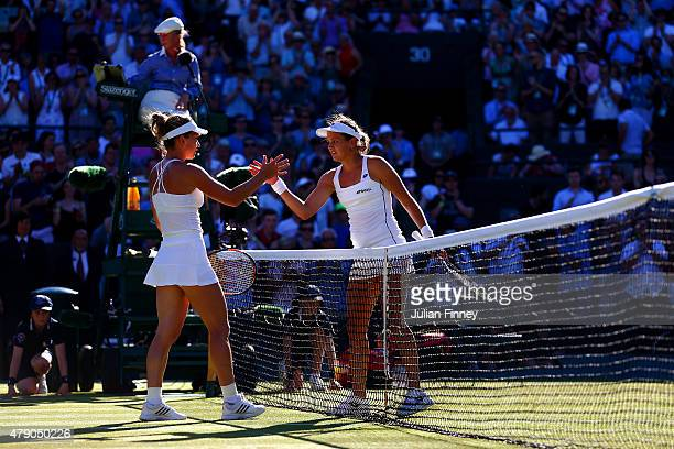 Jana Cepelova of Slovakia shakes hands with her opponent after winning her Ladies Singles first round match against Simona Halep of Romania during...