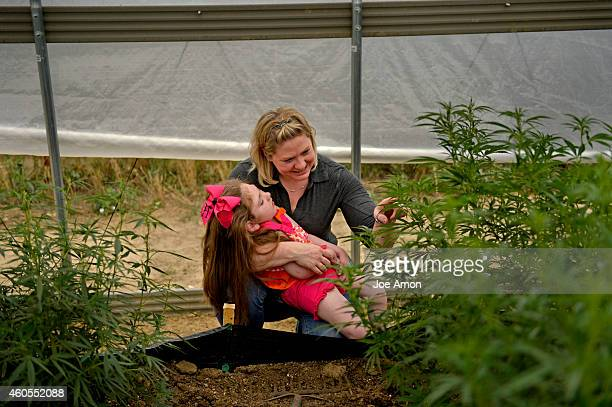 Janéa Cox director of the Flowering HOPE Foundation with her daughter Haleigh's who was diagnosed with LennoxGastaut syndrome looks at the plants...