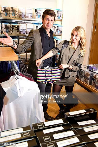 Jana Kilka and Thore Schoelermann fool around in the men's department during the Anson's Fashion Night on October 1 2014 in Hamburg Germany