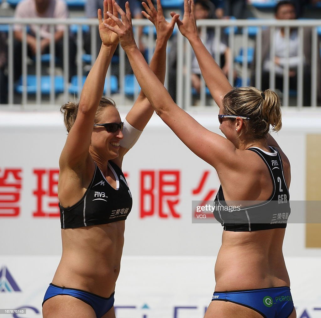Jana Kohler and Anni Schumacher (R) of Germany celebrate a goal against Jantine van der Vlist and Marloes Wesselink of The Netherlands during the women's qualification of FIVB Beach Volleyball Shanghai Grand Slam at Jinshan City Beach on May 1, 2013 in Shanghai, China.