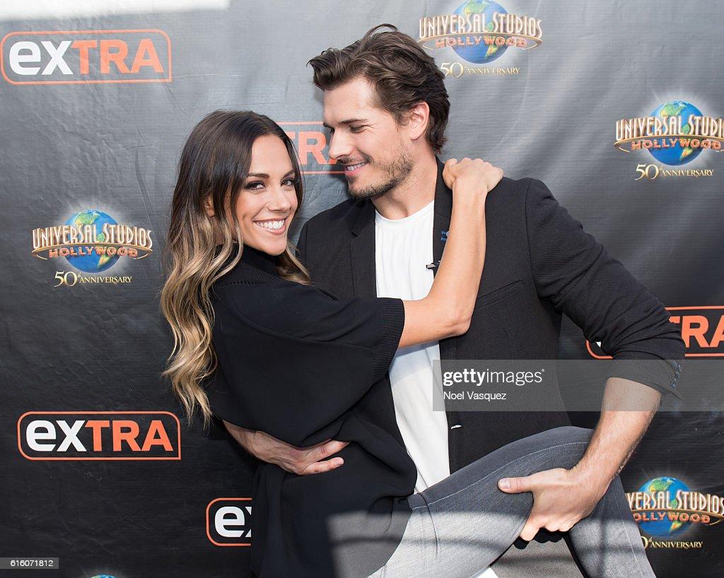 Jana Kramer (L) and Gleb Savchenko visit 'Extra' at Universal Studios Hollywood on October 21, 2016 in Universal City, California.