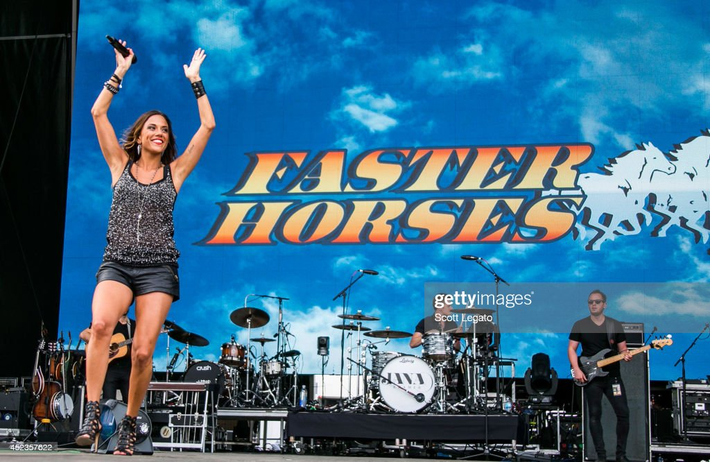Jana Kramer performs at Faster Horses Festival at Michigan International Speedway on July 18 2014 in Brooklyn Michigan
