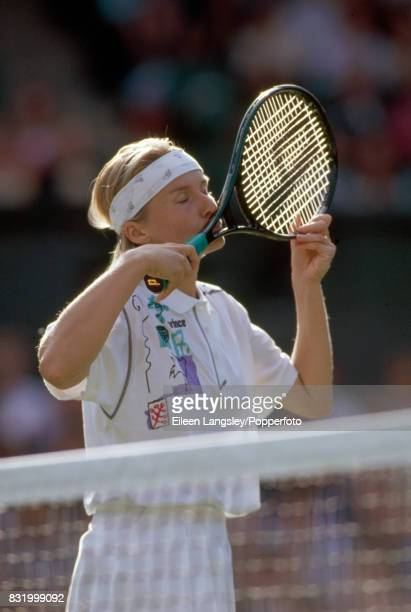 Jana Novotna of Czechoslovakia kisses her racquet during a women's singles match at the Wimbledon Lawn Tennis Championships in London circa July 1994...