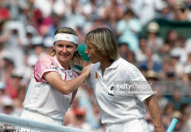 Jana Novotna of the Czech Republic defeats Martina Navratilova of the USA in a semifinal match in the women's singles at the Wimbledon Lawn Tennis...