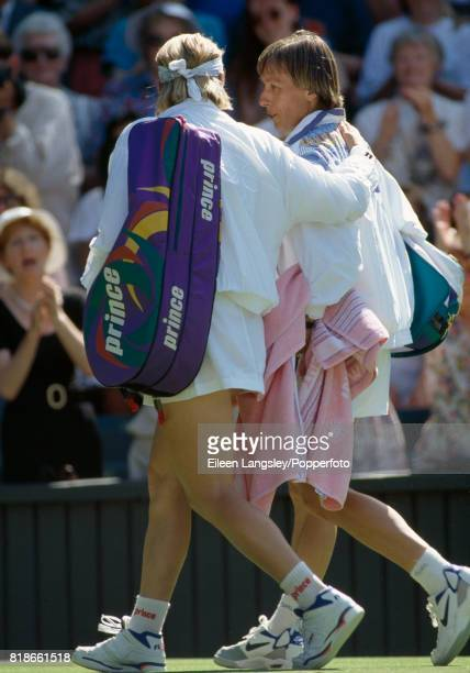 Jana Novotna of the Czech Republic is defeated by Martina Navratilova of the USA in a quarterfinal match in the women's singles at the Wimbledon Lawn...